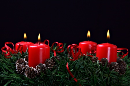 religious holiday: Advent wreath against black background