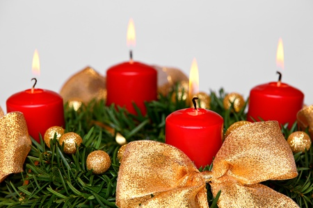 advent candles: Four burning candles on advent wreath