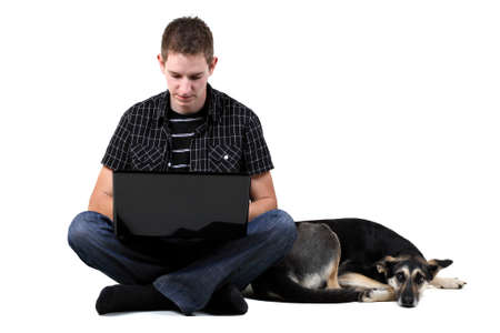 Young man with dog and laptop, isolated on white photo