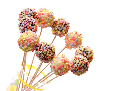 Colorful cake pops, isolated on white