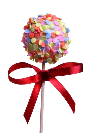 cake ball: Cake Pop with red ribbon, isolated on white  Stock Photo