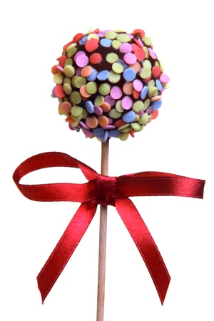 chocolate sprinkles: Cake Pop with red ribbon, isolated on white  Stock Photo