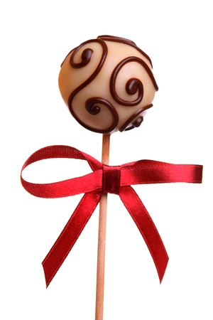 Cake Pop with red ribbon, isolated on white  photo