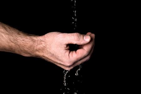 Male hand and running water Stock Photo