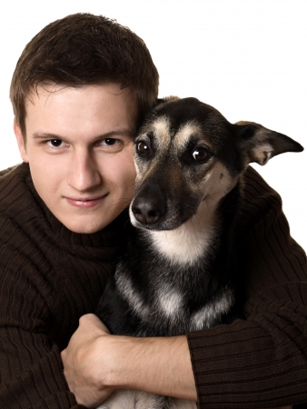 dog pose: Young man with mixed breed dog, isolated on white Stock Photo