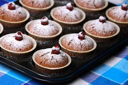 Muffins in baking tray photo
