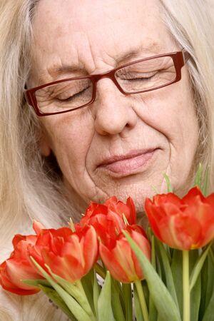 closed eye: Beautiful senior woman with modern glasses