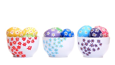 Colorful hand painted easter eggs in ceramic bowls, isolated on white Stock Photo - 12718049