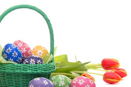 Easter concept with hand painted eggs, green basket and tulips, isolated on white Stock Photo - 12718113
