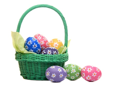 Hand painted easter eggs in green basket, isolated on white Stock Photo - 12718159