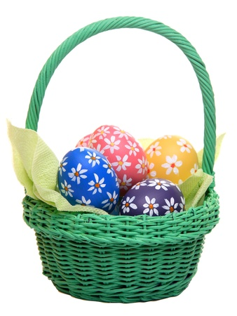 Hand painted easter eggs in green basket, isolated on white Stock Photo - 12718188