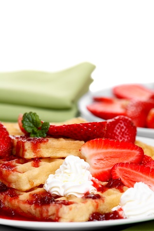 Waffles with fresh strawberries, cream and strawberry sauce  photo
