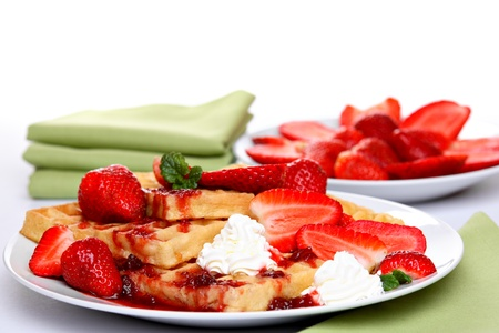 Waffles with fresh strawberries, cream and strawberry sauce  Stock Photo - 13067923