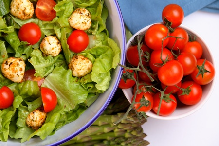 Mixed salad with mozzarella and small cherry tomatoes photo