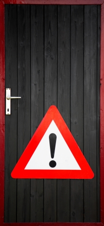 exclaim: Wooden door with exclamation warning sign