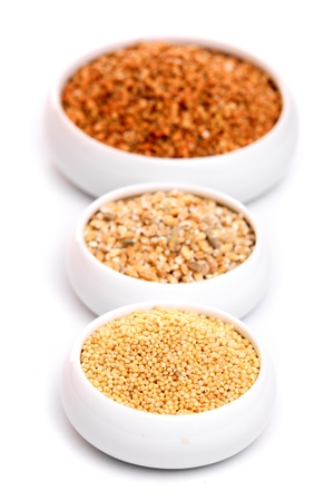 buckwheat: Millet, buckwheat grains and barley in ceramic bowls, isolated on white