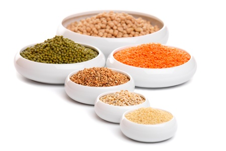 buckwheat: Millet, barley, buckwheat grains, red lentil, green soybeans and chick peas in ceramic bowls, isolated on white