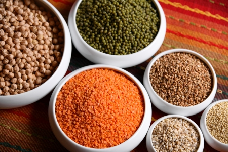 Millet, barley, buckwheat grains, red lentil, green soybeans and chick peas in ceramic bowls  Stock Photo - 13969658