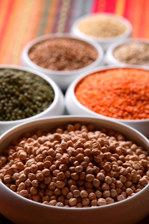 buckwheat: Millet, barley, buckwheat grains, red lentil, green soybeans and chick peas in ceramic bowls