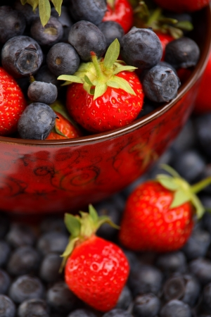 Bowl of fresh strawberries and blueberries  Stock Photo - 13969655