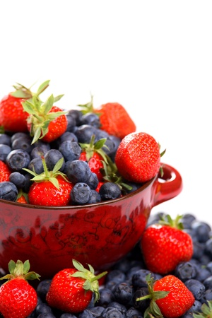 Bowl of fresh strawberries and blueberries, isolated on white with copy space  Stock Photo - 13969666