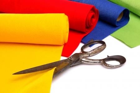 white fabric: Different felt rolls with big scissors  Stock Photo