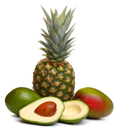 Avocado, pineapple and mango, isolated on white  photo