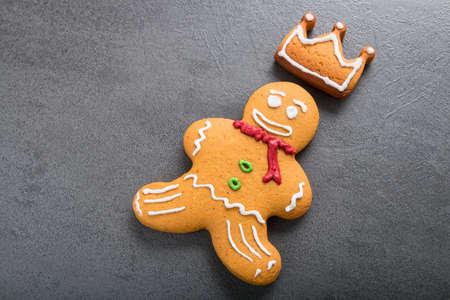 Christmas homemade gingerbread man on dark background.