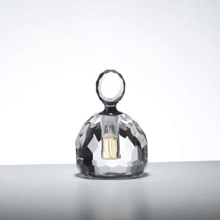 vintage bottle: Perfume bottle isolated on a table Stock Photo