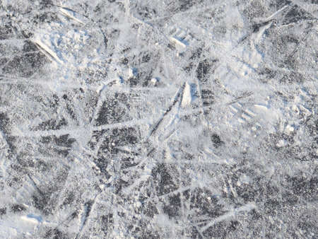 Surface of the outdoor skating rink marked with traces of skates and replete snow Stok Fotoğraf