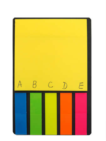 Block of multicolored paper stikers. Accessory for office.