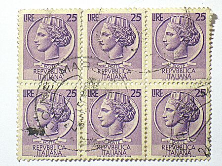 Italian lady face postage stamp, circa 1953 photo