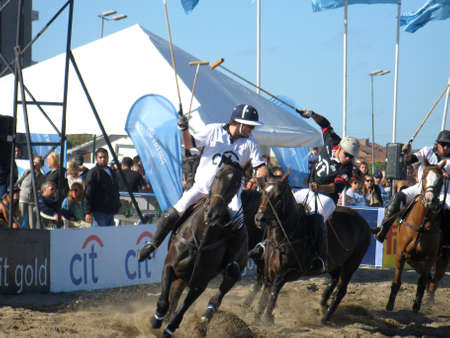 (darker) Pinamar beach (Sea Avenue crossing Retama Street), Argentina, January 2, 2013, open door exhibition, Beach Polo Sancor Grand Slam
