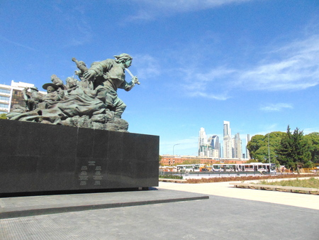Buenos Aires, Argentina, March 22 of 2019, San Nicol?s neighborhood, financial neighborhood, Juana Azurduy monument with Puerto Madero skyline in the background