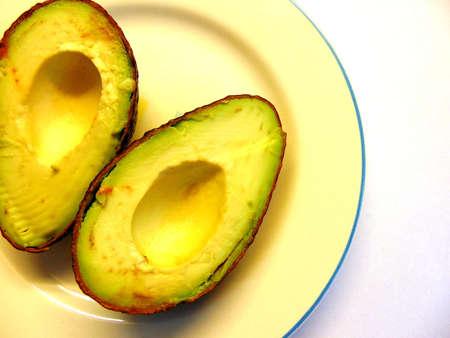 Avocado halfs in porcelain plate