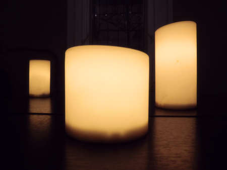 lighted: the photo of candles on the table
