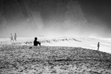 siting: Siting on the beach at Praia Grande, Portugal