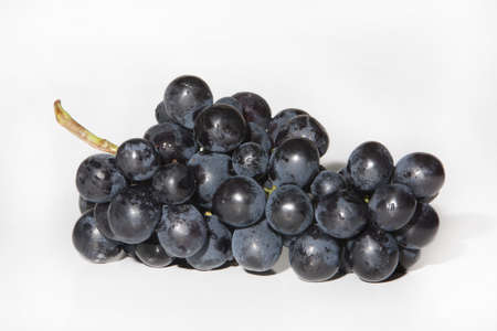 tip of the leaf: grapes, a fruit to eat in salads or fruit to make wine. Stock Photo