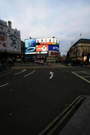 piccadilly: The cityscape of a very busy place in London - Piccadilly Circus Editorial