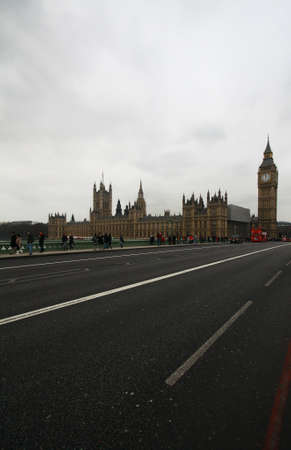The parliament on the bridge over the river in London. photo