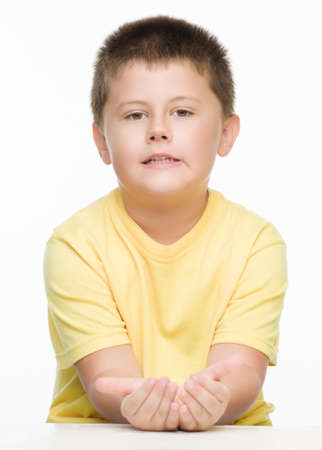 motioning: boy motioning with his hand Stock Photo