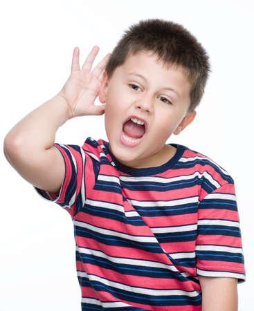 boy making gesture que not heard