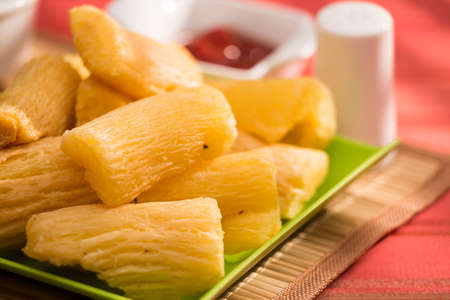 Brazilian food fried yucca. Deep fried cassava root.