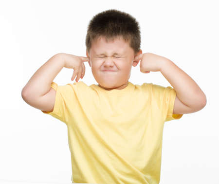 capping: boy afraid of noise Stock Photo