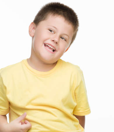 yellow shirt: boy laughing yellow shirt Stock Photo