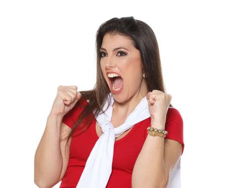 vibrating: Beautiful red cheerleader vibrating at goal Stock Photo