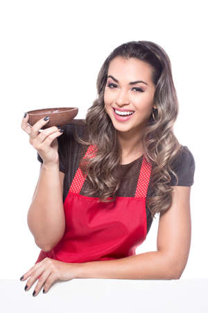 Beautiful young woman holding a chocolate egg Imagens