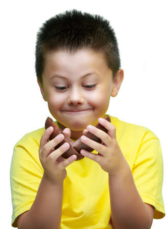 chocolate eggs: boy eating delicious chocolate eggs, celebrating Easter