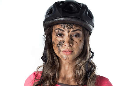 mud woman: Woman covered in mud when riding a bike