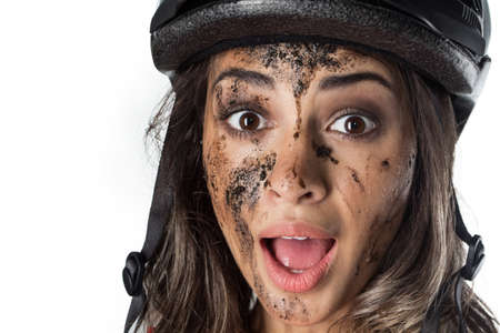 Woman covered in mud when riding a bike